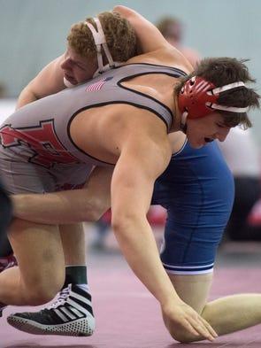 Christian Salter of Siegel wrestles Antonio Carter