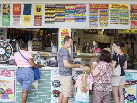 Customers wait for their ice cream outside The Ice Cream Store in Rehoboth Beach on Monday afternoon.