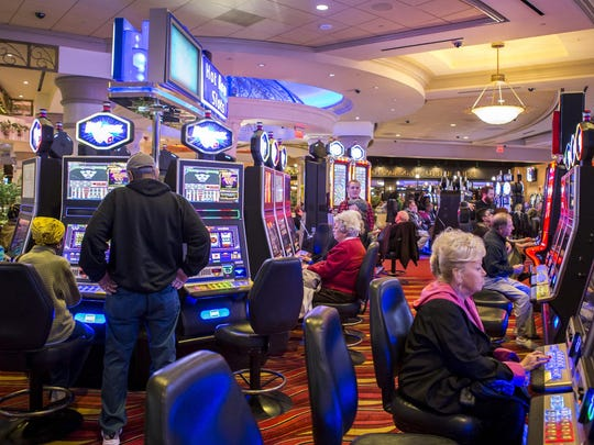 Gamblers play the slots at Dover Downs. The hotel and casino reported a net loss of $184,000 in the first quarter of 2017.