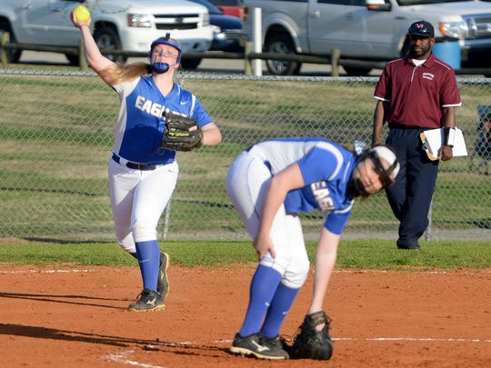 Jackson Christian's Abby Roberson throws to first base for an out against Madison on Tuesday.