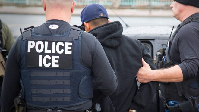 U.S. Immigration and Customs Enforcement agents make an arrest in Los Angeles. AP file photo U.S. Immigration and Customs Enforcement agents make an arrest in Los Angeles.