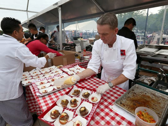 James Kelly of Restaurant X in Congers prepares burgers at the Burger & Beer Blast at the Kensico Dam Plaza in Valhalla, part of the Westchester Wine & Food Festival on June 8, 2017.