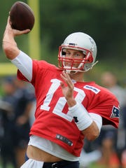New England Patriots quarterback Tom Brady (12) works on passing drills during a joint practice with the NFL football team Houston Texans in White Sulphur Springs, W.Va., Wednesday, Aug. 16, 2017. (AP Photo/Chris Jackson)