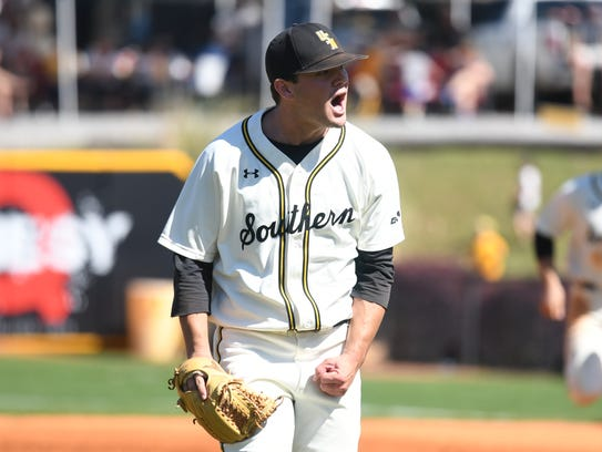 Southern Miss pitcher Stevie Powers shouts at the end