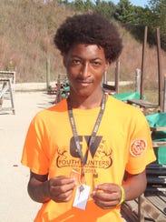 Joshua Arnold, an 11th-grader at Escuela Verde charter