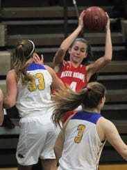 Dixie Heights' Celia Pelfrey drives into the lane during