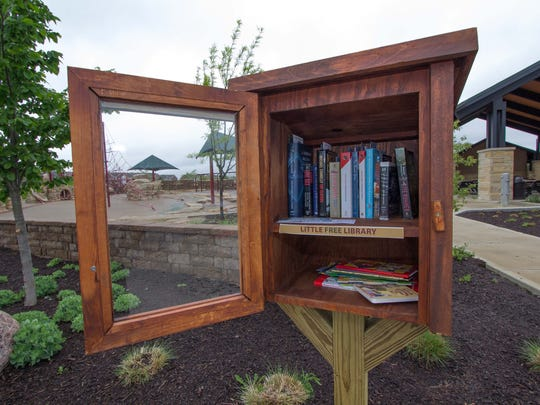 A Little Free Library at Founders Park, Carmel, is full of books, May 15, 2014. The Little Free Libraries are all over the metro area. People can borrow books for free with no late fees and no due date.
