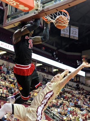 Feb 28, 2015; Tallahassee, FL, USA; Florida State Seminoles guard Robbie Berwick (24) fouls Louisville Cardinals forward Montrezl Harrell (24) as he dunks the ball during the first half of the game at the Donald L. Tucker Center. Mandatory Credit: Melina Vastola-USA TODAY Sports