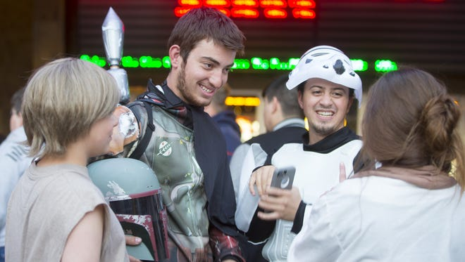 Star Wars fans Daniel Beebe, of Cave Creek, left, and Tim Parra, of Chandler, come dressed to see Star Wars: The Force Awakens at Harkins Tempe Marketplace on December 16, 2015.
