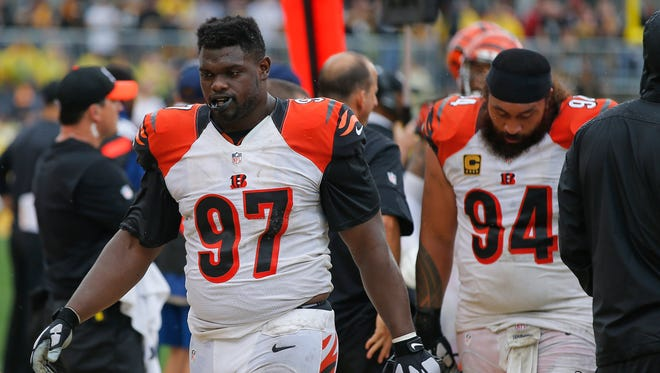 Cincinnati Bengals defensive tackle Geno Atkins (97), left, and defensive tackle Domata Peko (94) walk off the field after the fourth quarter during the Week 2 NFL football game between the Pittsburgh Steelers and the Cincinnati Bengals, Sunday, Sept. 18, 2016, at Heinz Field in Pittsburgh.