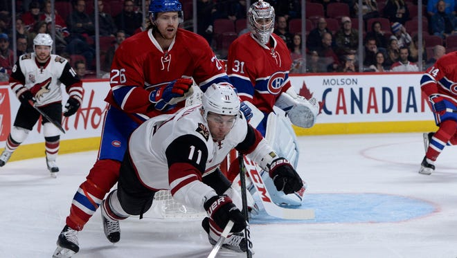 Oct 20, 2016: Arizona Coyotes forward Martin Hanzal (11) dives for the puck while Montreal Canadiens defenseman Jeff Petry (26) defends during the first period at the Bell Centre.