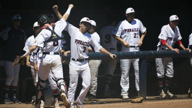 Pinnacle's Devin Bonadeo (8) celebrates with teammate Luke Woods (3) after a strikeout to end the inning against Sanda Day O'Connor during a State Playoff game at Pinnacle High School in Phoenix, Ariz. on April 29, 2017.