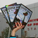 Daren Easterling of Tampa, Fla., sells programs for $20 prior to Super Bowl XLII on Sunday, Feb 3, 2008 at the University of Phoenix Stadium in Glendale, Arizona.
