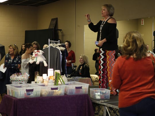 Sheila Mobley, owner of Detailz Mobile Boutique, addresses the crowd at the Ladies Day Pop Up Event held last Saturday at The Force 2.0 studio in Farmington.