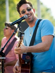 Jake Owen performs during a listening party for his new album at Blue Moon, Monday, July 18, 2016, in Nashville, Tenn.
