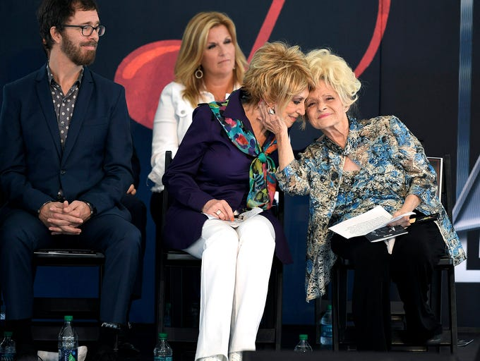 Brenda Lee,right, embraces Jeannie Seely during an