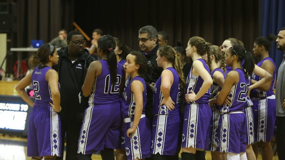 New Rochelle coach Bob Bynum (second from left) talks