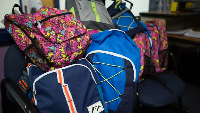 MacArthur Elementary School receives 10 backpacks filled with school supplies, August 4, 2016, donated from inmates with the PAWS program at Southern New Mexico Correctional Facility. In all, prisoners and prison employees donated 24 backpacks with school supplies to three schools.
