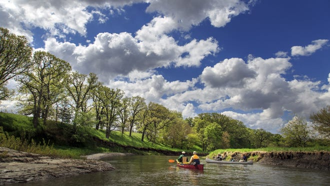 Rex Harvey and Steve Row, left, and Ray Harden and Ty Smedes paddle down the Raccoon River in Sac County Thursday, May 19, 2016.