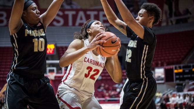 Ball State's Oshlynn Brown attempts to shoot inside the zone as Purdue closes in with two of their defensive players on March 18 during the Women's National Invitational Tournament inside Worthen Arena. Purdue won the game 77-72.