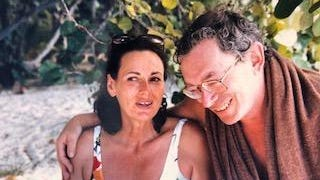 Norman Mintz and his wife, Marcia, on a Caneel Bay beach.