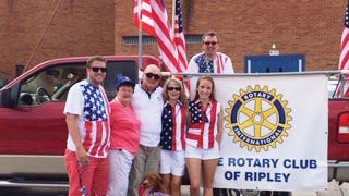Ripley Rotarians proudly display the Rotary Club of Ripley banner.