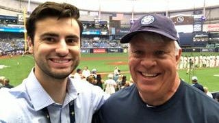 Brad Ballew, left, poses with his father, Bill, prior to a past Tampa Bay Rays game.