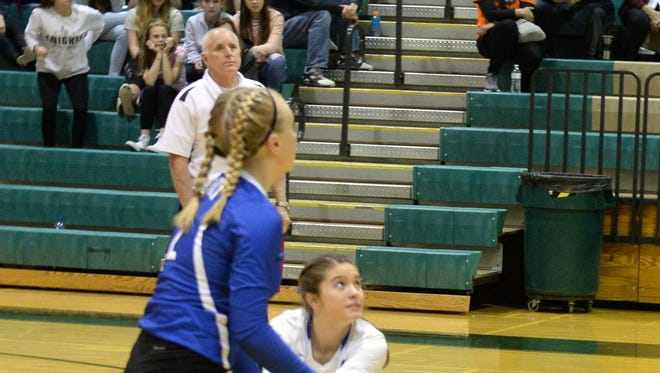Fort Defiance's Casey Mozingo and Ashley Humphries (blue jersey) wait for a ball during the 2017 Valley District volleyball championship game.