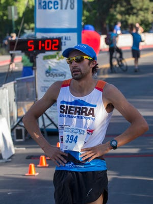 Brandon Nied from Reno after finishing first in the Reno 10 mile race held on Sunday, August 14, 2016.