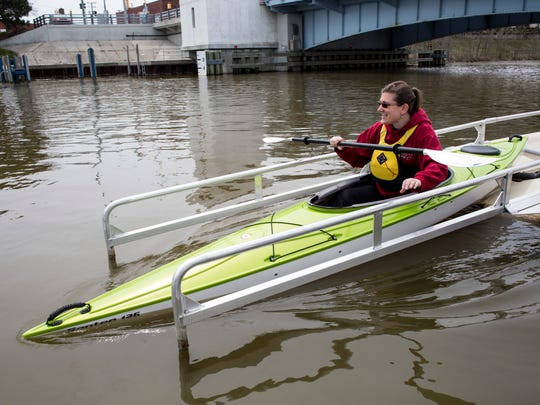 Tiffany Sassanella, of Fort Gratiot, uses a kayak launch