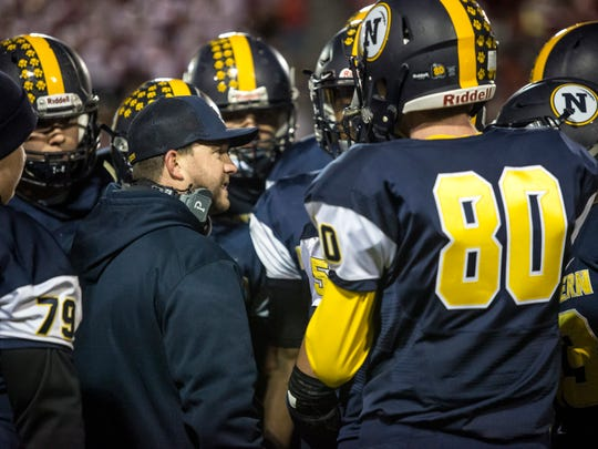 Port Huron Northern coach Larry Roelens talks with players during the Crosstown Showdown Friday, Oct. 21, 2016 at Memorial Stadium in Port Huron.