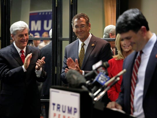 Gov. Phil Bryant, left, applauds as Mississippi Republican Party Chair Joe Nosef speaks during a press conference at MSGOP headquarters in Jackson Wednesday.