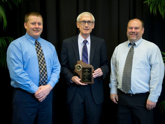 Gillett teachers Greg Zeitler, who teaches seventh and eighth grades, and Bryan Brown, a sixth grade teacher, accepted Title 1 School of Recognition the award for Gillett Middle School from State Superintendent Tony Evers at a ceremony in Madison on May 21.