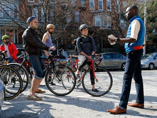 Former Black Lives Matter protester DeRay McKesson, right, chats with bicyclists during his unsuccessful bid for mayor of Baltimore.