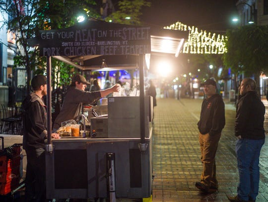 Neil Solis of the South End Sliders food cart prepares