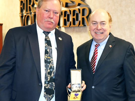 Freddie Parris receiving Purple Heart from State Treasurer