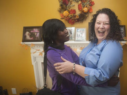 Latina Hart (left) shares a laugh with her Samaritan on-call RN, Patti Ramirez at her daughter's home Gloucester County. Hart is a Samaritan Hospice patient, who recently moved in with her daughter. Hart has taken all the necessary steps to prepare for her death.