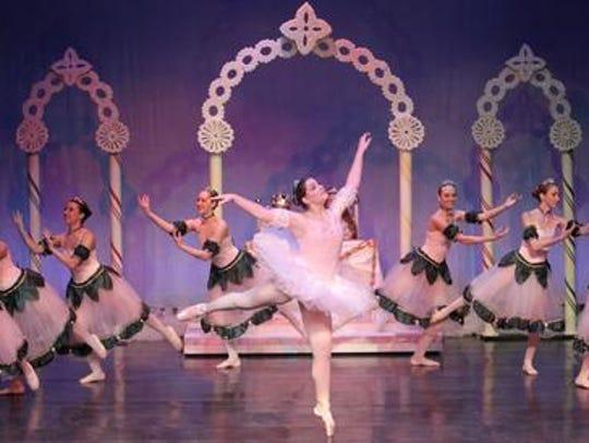 Elizabeth Claessens of Marshfield dances during rehearsal