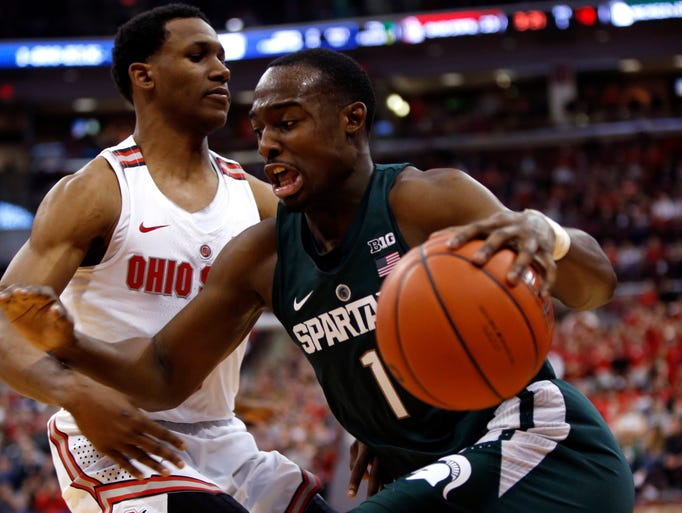 Michigan State guard Joshua Langford, right, drives