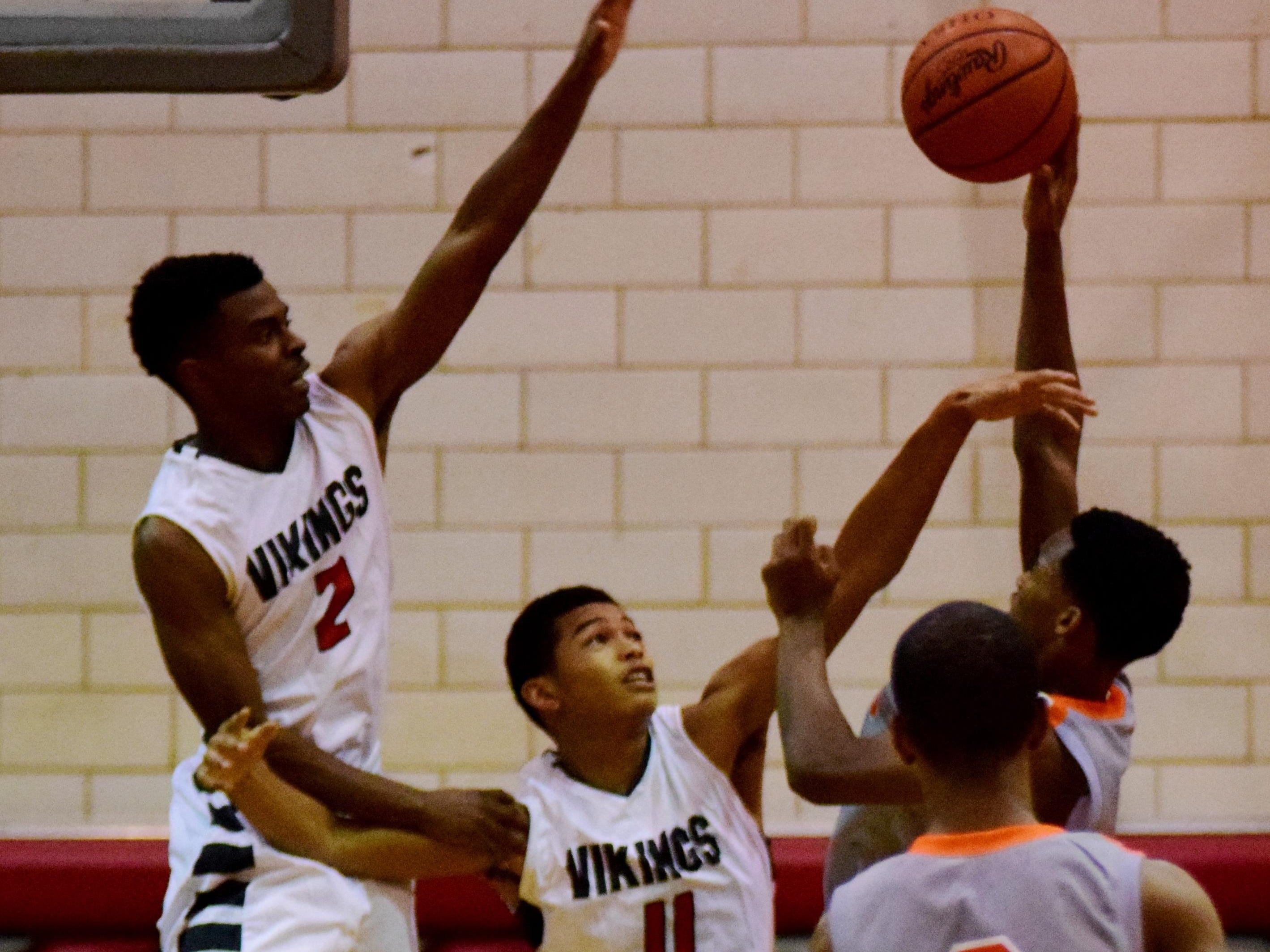 Princeton's Justin Newman, No. 11, attempts to block a shot against Withrow last season.