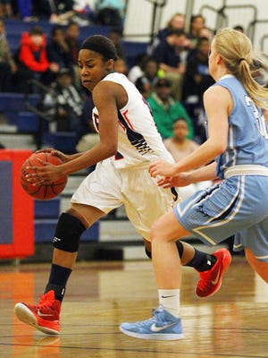 BHP High School's Shanteal Davis drives to the basket in the first quarter.