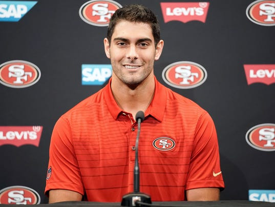 Jimmy Garoppolo wearing San Francisco 49er polo at a news conference