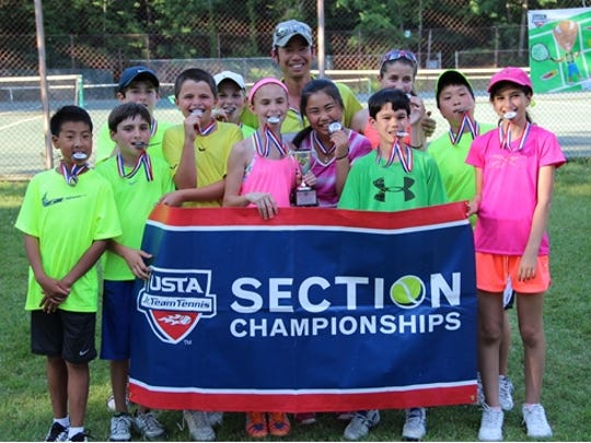 The Rye Racquet Club USTA 12 & Under Intermediate team section finalists. Front row, from left, Justin Cheigh (Rye), Reece Mullahy (Rye), Doug Yaffa (Harrison), Juliette Nask (Mamaroneck),Yui Inagawa (Greenwich), James Cruz (New Rochelle), Eddie Nakamura (Rye) and Farida Ibrahim (White Plains). Back row, from left, Nicolas Jaramillo (Rye), Finlay Ryan (Rye), Coach Go Inagawa and Alison Zerbib (Larchmont). Not pictured: Jessica and Sydney Saviano (Harrison).