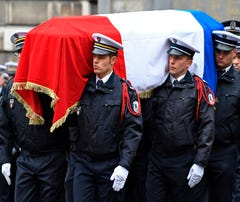 France honors policeman killed in Champs-Elysees attack