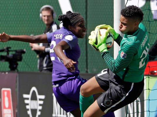 FILE - In this April 15, 2017, file photo, Portland Thorns goalie Adrianna Franch, right, stops a scoring attempt by Orlando Pride forward Jasmyne Spencer during the second half of their NWSL soccer match in Portland, Ore. The National Women's Soccer league opens its sixth season this weekend. The defending champion Portland Thorns play the North Carolina Courage on Saturday, with both teams looking to build on last year's success. (AP Photo/Don Ryan, File)