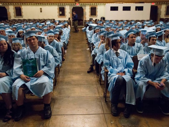 Graduates wait in the Great Falls High School theatre