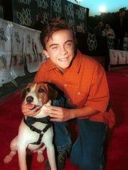 "Frankie Muniz and his co-star of ""My Dog Skip."""