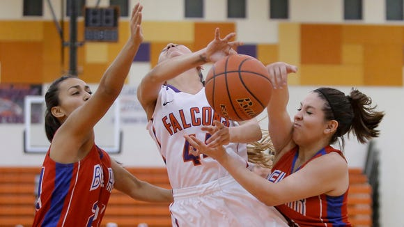 Eastlake's Alexia Gonzalez has the ball slapped away by Bel Air's Anaya de la Cruz, right, and Bianca Avalos during their game Friday night at Eastlake High School.