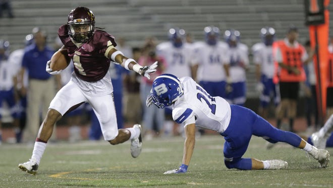 Andress safety Otho Redding returns a fumble stiff arming Bowie receiver Patrick Moran along the way.