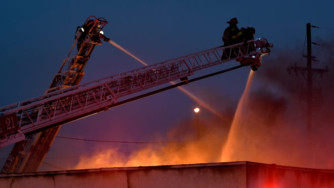 Nashville Fire battles a fire in the 900 block of 8th Ave South in Nashville on Sunday, Feb. 11, 2018.
